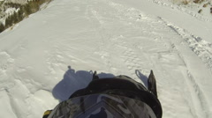 Snowmobile ride high mountain trail POV Stock Footage