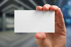Hands holding a white business visit card, gift, ticket, pass, p Stock Photos