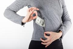 Hands holding money. Bribe in businessmen's pocket. Dollars cur - stock photo