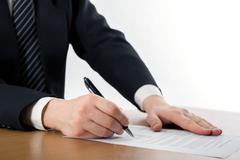 Businessman's hand signing papers. Lawyer, realtor, businessman - stock photo