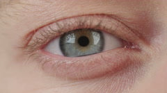 Close up shot of a woman's blue eyes Stock Footage