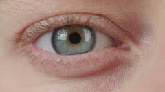Close up shot of a woman's blue eyes - stock footage