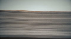 A stack of papers on the table (horizontal camera movement) Stock Footage