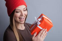 Cute young girl is receiving a present - stock photo