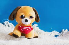 plush toy dog with red heart - stock photo
