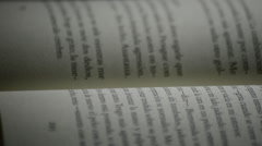 Phrases and words in spanish of a page of a open book rotating Stock Footage