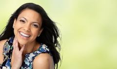 Beautiful Asian woman face over floral background. Stock Photos