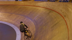 4K Cyclists on racing track in velodrome doing victory lap with USA flag Stock Footage