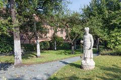 ANTWERP, BELGIUM - AUG 13: Courtyard garden with statue and old historic hous - stock photo