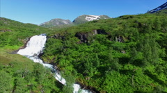 Flying above a beautiful waterfall in Norway Stock Footage
