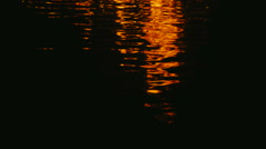Warm fire reflections on water Stock Footage