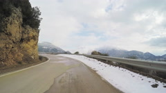 POV vehicle car drive road winter rural scenery snow clouds sky mountain peaks Stock Footage