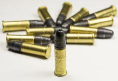 .22 caliber Long rifle Rimfire Ammunition on white Stock Photos