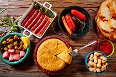 Tapas mix spanish potatoes omelette sausages - stock photo