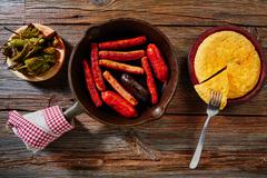 Tapas spanish potatoes omelette and sausages - stock photo