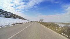 POV vehicle drive countryside open road winter snow blue sunny sky car travel - stock footage