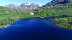Scenic lake with waterfall in Norway, aerial view Stock Footage