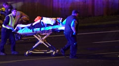 Medical Transporting Patient To An Ambulance After A Crash - stock footage