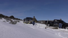 Truck stuck in winter snow tow out HD Stock Footage