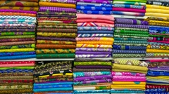 Pile of cloth fabrics at a local market in Bangladesh. Stock Footage