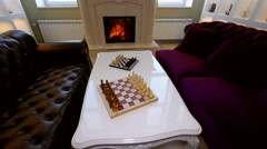 Panorama room with sofas, a fireplace and chess. Stock Footage