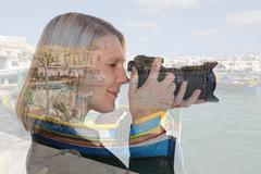 Woman vacation holidays travel traveling taking photos with camera double exp Kuvituskuvat