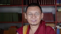 Happy Buddhist Monk librarian headshot Stock Footage