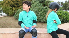 Young boy and girl with roller skate - stock footage