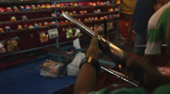 People playing toy gun in theme park Stock Footage