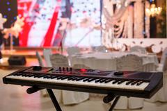 Piano Keyboard synthesizer in  festive room,Front view - stock photo