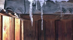 Snow and icicles melt comes spring Stock Footage