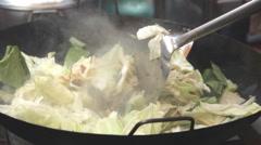 Preparing vegetables with stir fry Stock Footage