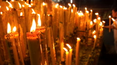 People light candles for prey in Chinese shrine - stock footage