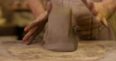 Male potter kneads clay in his studio. Slow motion. Stock Footage