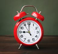 The red alarm clock showing 9-00 hours. Stock Photos