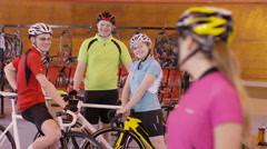 4K Portrait of cheerful young cyclist standing beside the track in velodrome - stock footage
