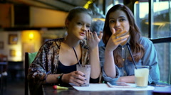 Girlfriends gossiping in the cafe and laughing  Stock Footage