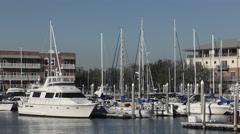 Sail boats and Fishing Boats at a Marina Stock Footage