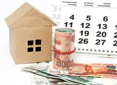 House, calendar and money on a light background Stock Photos