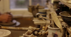 Potter working with clay on a spinning wheel. Stock Footage