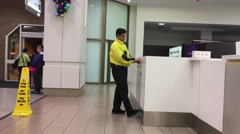 One side of security locking the door at Burnaby shopping mall - stock footage
