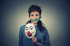 Diet restriction and stress concept. Portrait of young sad woman with clown m - stock photo