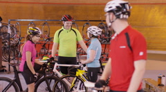 4K Portrait of cheerful young cyclist standing beside the track in velodrome Stock Footage