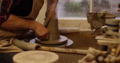 Shot of a man making a ceramic pot in a workshop. Slow motion. Stock Footage