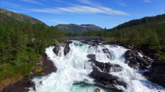Flying close above waterfall Likholefossen in Norway Stock Footage