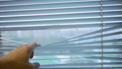 Hand opening blinds Stock Footage