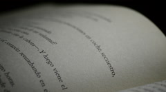 Page of a old open book with words, phrases and texts in castillian, rotating Stock Footage