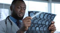 Male doctor viewing mri picture Stock Footage