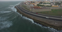 Aerial shot going over and around the Cafe del Mar coastal bar in Cartagena Stock Footage