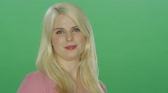 Beautiful blonde woman with blue eyes smiling, on a green screen background Stock Footage